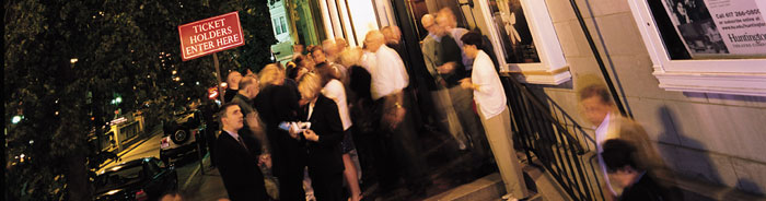 Whether backstage' in Front of House' or working at a special event' Huntington volunteers have the unique opportunity to assist the theatre and at the same time become a part of the Huntington family.   Ushers — Help support the Huntington!   Volunteer ushers are a vital part of the theatre's Front of House operations. More than 1'280 volunteers are needed for more than 160 performances each season!   Volunteer ushers should check in with the House Manager and Head Usher upon arrival. Arrival times may vary, depending upon the venue. Volunteer ushers are expected to hand out programs' help seat patrons before the show starts' and answer basic questions which patrons have about the theatre. In exchange' ushers can see the performance free of charge and get an inside look at the workings of a professional theatre company.	  Many people' including couples' families' and friends volunteer at the Huntington. Please join us!   Choose a venue:  Usher performances at the Boston University Theatre   Usher performances at the Calderwood Pavilion at the BCA
